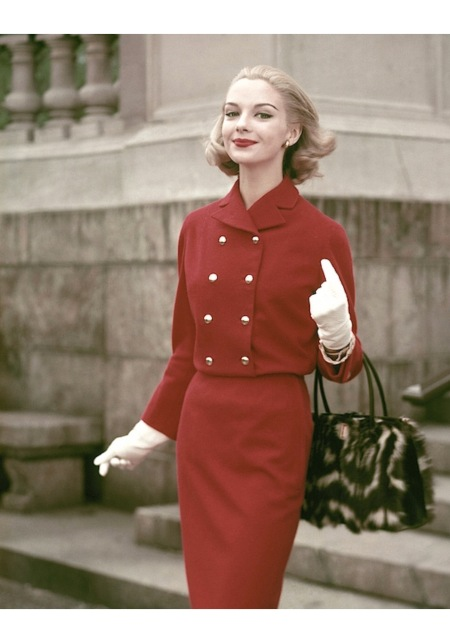 Gretchen Harris in a red suit by Junior Sophisticates, fur purse by Greta, gloves by Superb and bracelet by Arpad aug 1956