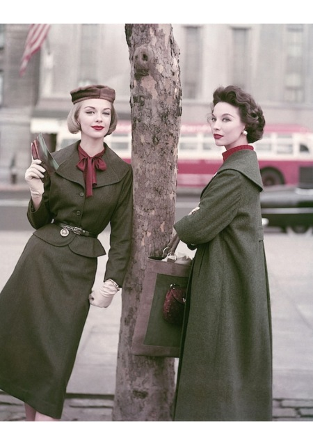 Gretchen Harris (l) n loden-green suit by H. & E. Shapiro Model on right wearing coat by Oppenheimer-Franken aug 1956
