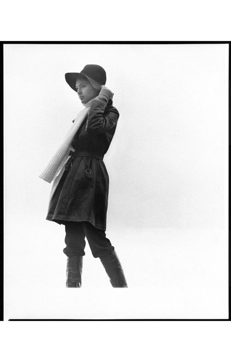 Jacqueline Bisset wearing a short leather trenchcoat with zippered diagonal pockets by Highlander with a Juliano Knits ribbed wool scarf; broad-brimmed felt hat by Cerruti; Hansen gloves