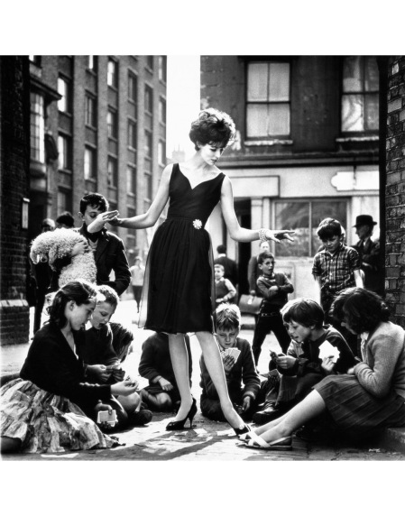 Jennifer Hocking in black chiffon over a straight taffeta skirt by Nettie Vogue Vogue July 1961 b
