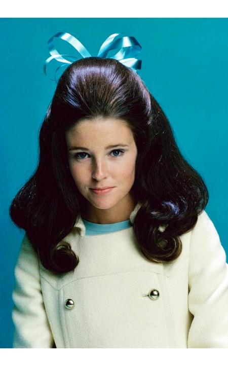 Lisa Palmer wearing a blue bow Glamour Nov 1966