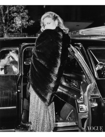 Lisa Taylor wearing a black mink poncho with handkerchief point in back, ties at neck, by Pauline Trigere for the House of Black Diamond, over a long shimmery dress Vogue 1976 © Bob Ric