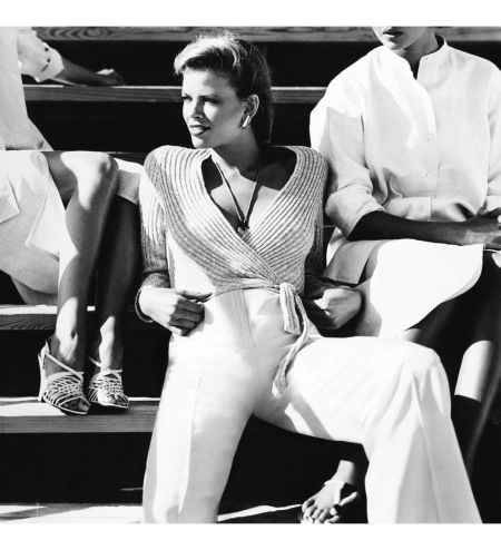 Lisa Taylor wearing a John Anthony sweater on bleachers Vogue Nov 1976