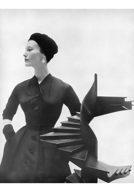 Mary Jane Russell in black ribbed silk evening coat-dress by A. Goodman, John-Frederics hat, Trifari jewelry, photo by Gleb Derujinsky, Harper's Bazaar, September 1952