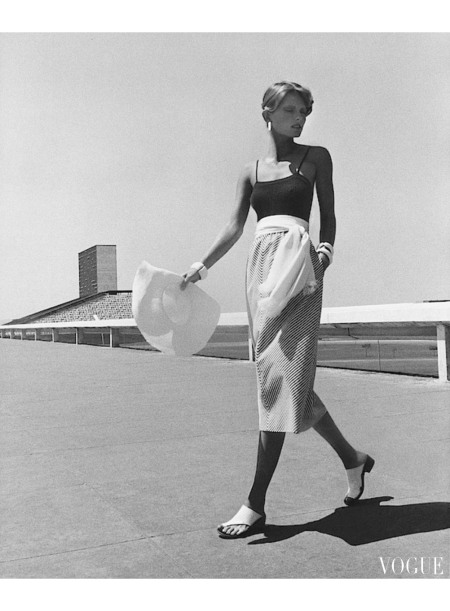 Model Cheryl Tiegs wearing a Blassport skirt on a balcony in Bahia, Brazil Vogue my 1972 © Kourken