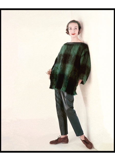 Model wearing a plaid sweater and leather pants by Bonnie Cashin and shoes by Fortunet glam aug 1958