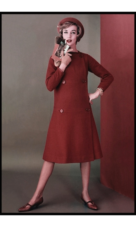 Model wearing a wool dress by Mr. Mort Sportswear, pumps by I. Miller, Tiffany & Co. bracelet and clutch by Walter Katten glam aug 1958