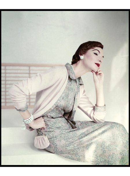 Model wearing Liberty silk dress under a cashmere cardigan Vogue Jan 1954