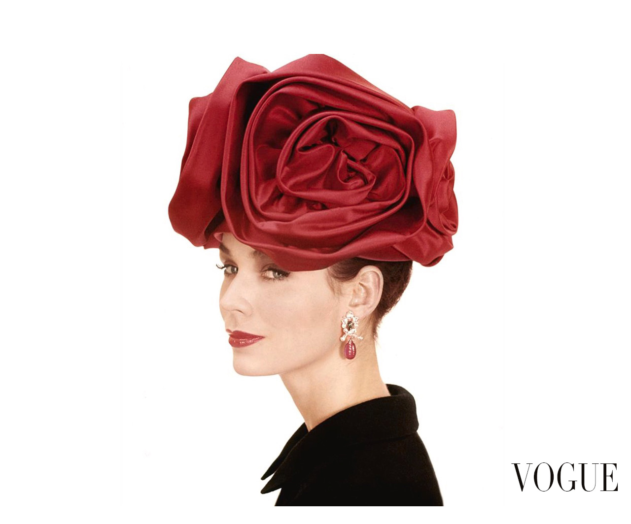 c9132d4953d Portrait of a model wearing a hat of large red satin roses by Lilly Dache  sept