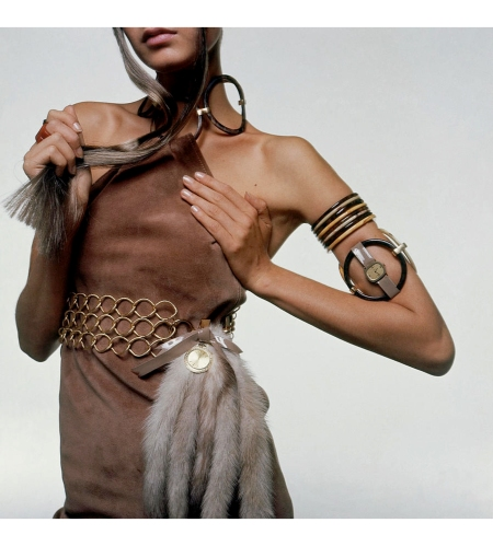 "Twiggy modeling Sant'Angelo bangle-harnessed mini-dress with gilt link belt by Saint Laurent for Colony; Watches by Rolex and Omega; Hausfeld pearl natural mink tails Vogue Nov 1967 ""W"