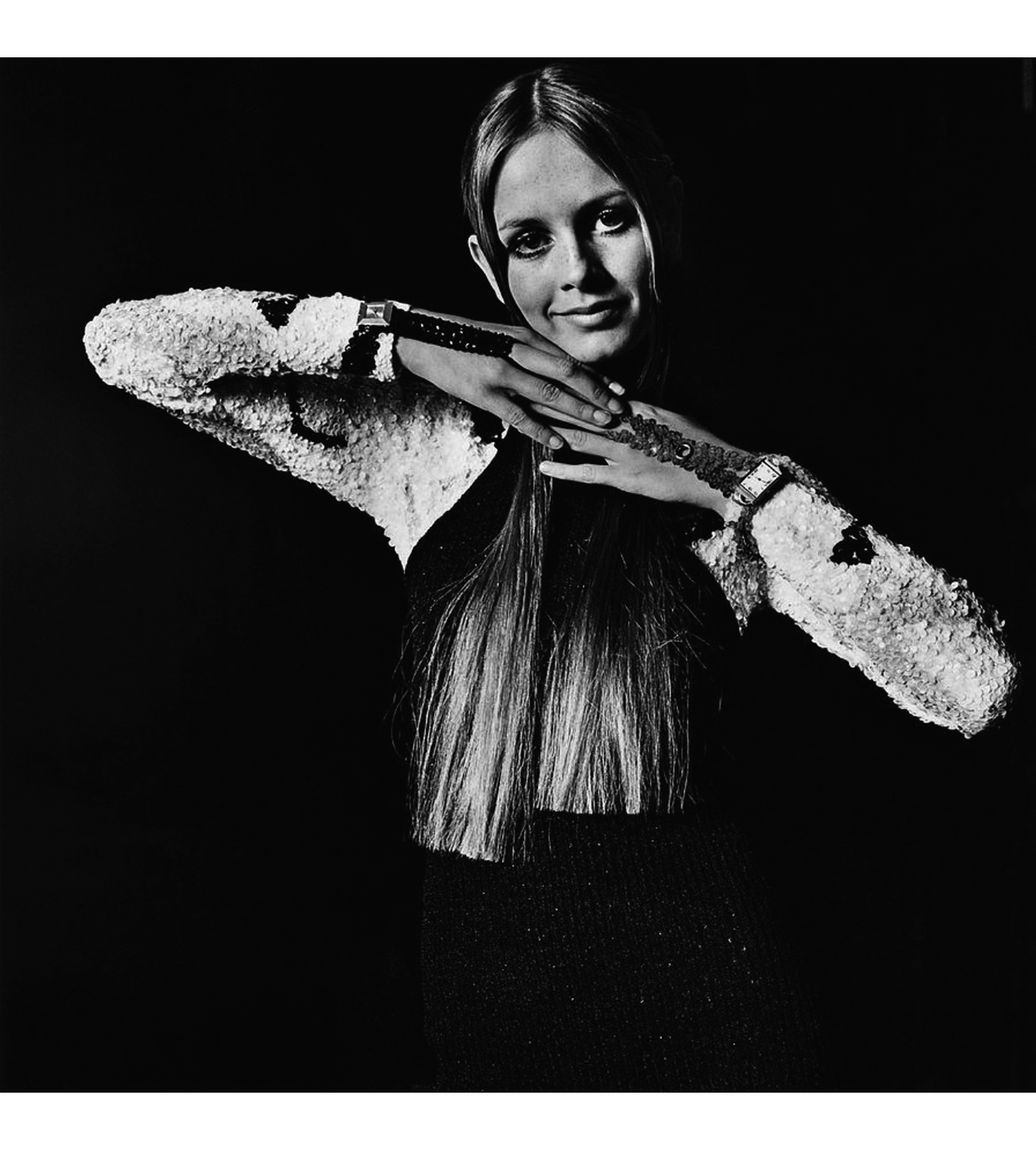 ace59548868a Twiggy wears a sequined jumpsuit by Gene Shelly for Boutique International   a black Hansen hand