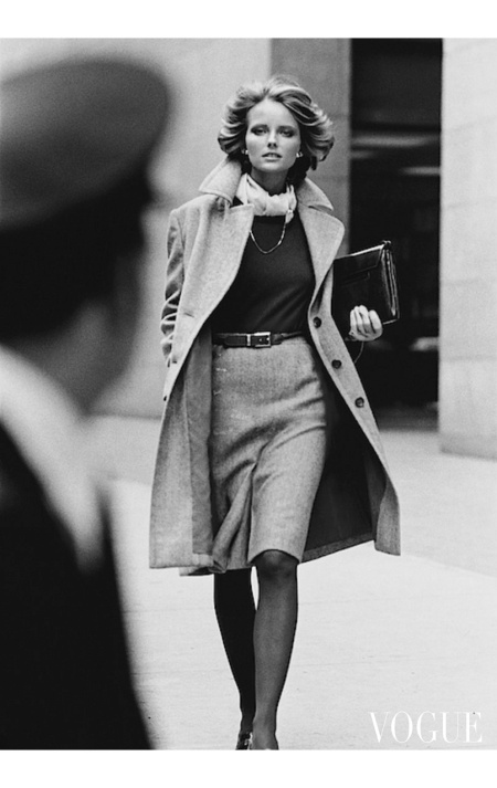 Cheryl Tiegs wearing a tweed overcoat and holding a Bottega Veneta bag June 1972
