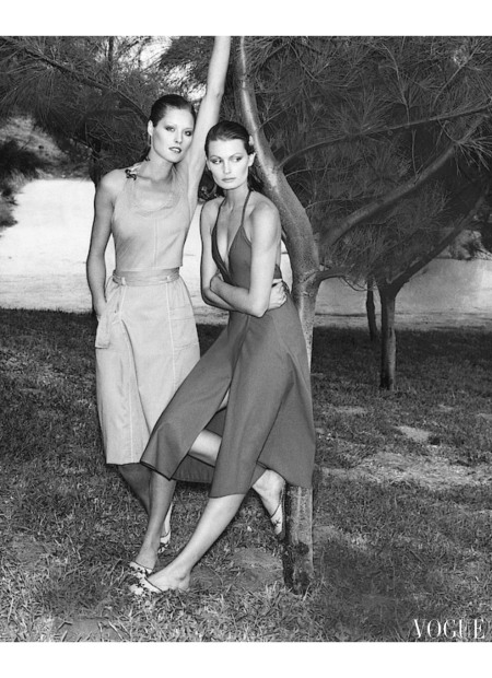 Denise Hopkins Models wearing a Dalton ensemble and a Calvin Klein dress leaning on a tree feb 1977