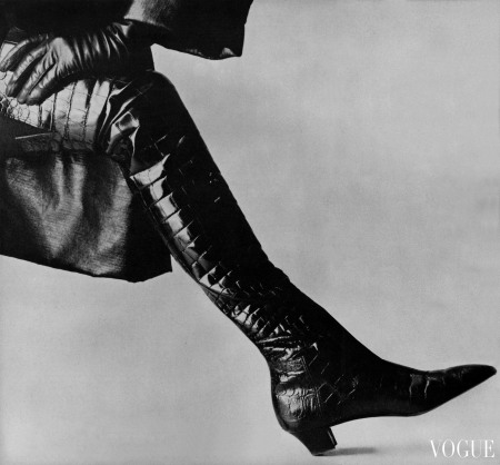 """Musketeer boots—shiny, thigh-high, shapely as legs,"" Vogue wrote of Roger Vivier_s crocodile thigh-highs for Yves Saint Laurent Vogue, September 1963 © Irving Penn"