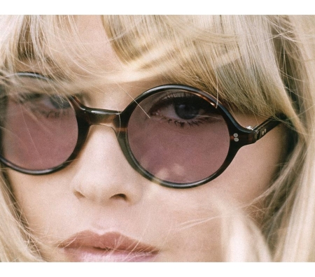 Headshot of model wearing 'tortoise' framed glasses with light purple lenses by Bernard Kayman Glamour jan 1968 © Frank Horvat
