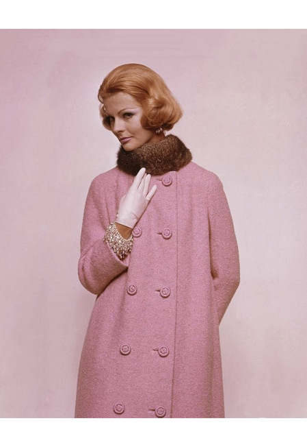 Model wearing collarless tweed coat in wool with cord buttons, Georges Kaplan opossum fur ruff with sequined sheath of silk chiffon beneath by Anne Fogarty Glamour Nov 1960 © Bert Stern
