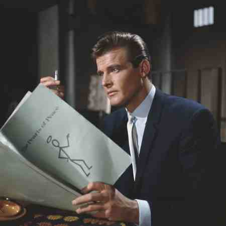 Moore, who played the character of Simon Templar, reads script for The Pearls Of Peace episode at Elstree Studios in 1962 © Popperfoto:Getty Images