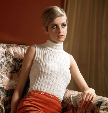 Twiggy wearing a fashionable white jumper whilst sitting on a sofa 1967 (Photo by Popperfoto:Getty Images)