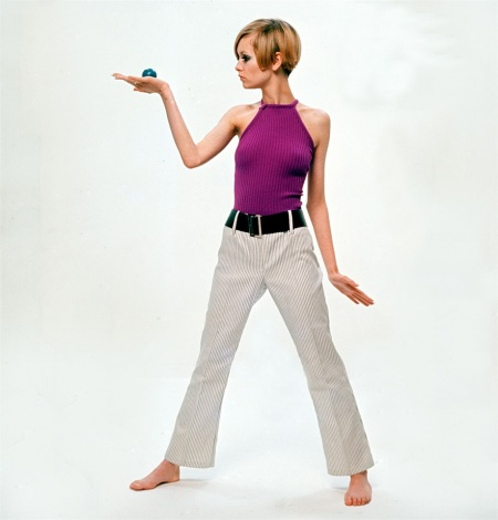 Twiggy wearing fashionable clothing whilst in a pose holding up a small round ball in her hand 1966 (Photo by Popperfoto:Getty Images)