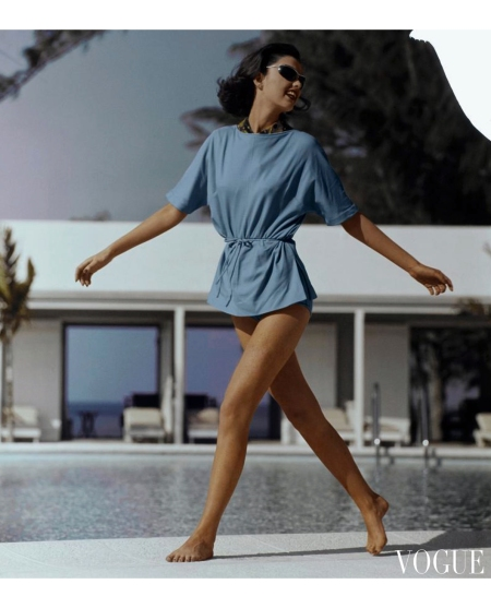 Model walking on the pool deck at the Lyford Cay Club in New Providence., Bahamas Vogue June 1960 © Frances McLaughlin-Gill