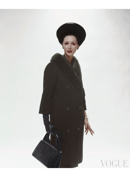 Model wearing a Sally Victor hat and a checked coat and carrying a crocodile Handbag Oct 1960 © Sante Forlano
