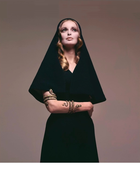 Samantha Jones, July 1968. Hooded dress in black wool crêpe by Trigère. Serpent armband from the collection of Harry Winston